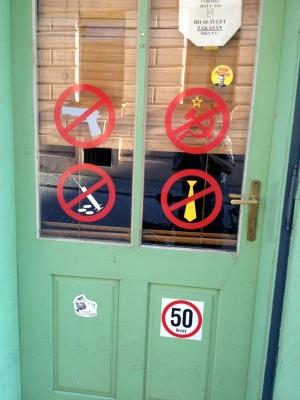 SIGNS ON A BAR DOOR-NO RUSSIANS