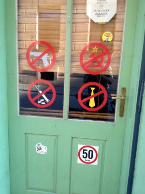SIGNS ON A BAR DOOR-NO RUSSIANS