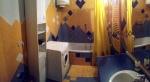BATH WITH SHOWER AND WASHING MACHINE