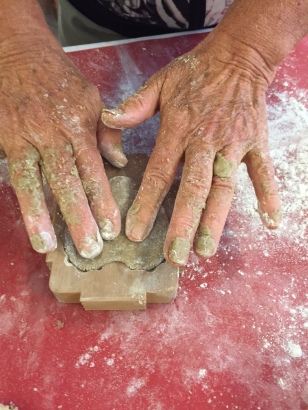 PRESSING DOUGH INTO MOLD