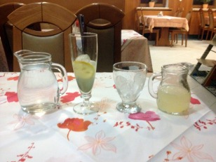 I'M GETTING AMERICAN SERVICE: LEMONADE, WATER, ICE AND COCKTAIL GLASS
