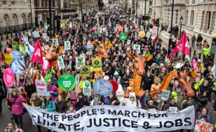 London, UK. 29/11/15. Tens of thousands march through central London ahead of the Paris Climate Conference. (© Rob Pinney / Avaaz)