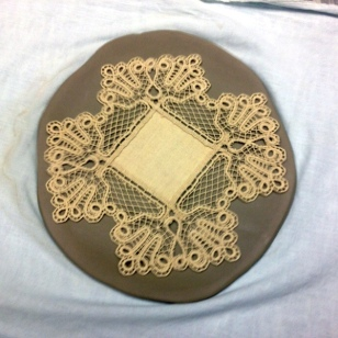 ROLL LACE ONTO CLAY TO MAKE EMBOSSED PATTERN