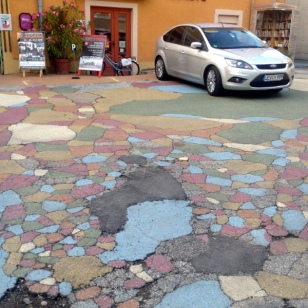 THEY PAINTED BROKEN ASPHALT, ACTUALLY LOOKS GREAT,